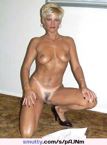 horny mature with huge tits stripping from nylon stockings